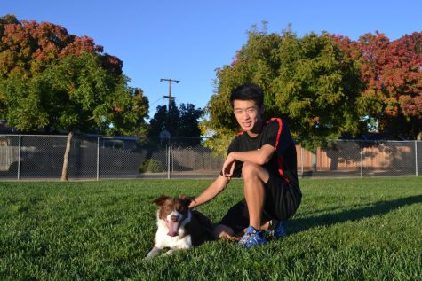 Radence Tsow hurdles over competition with his dog