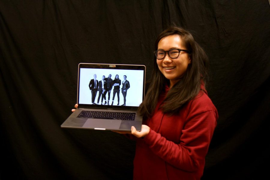 Nicole holds a laptop showing an image from the opening sequence of