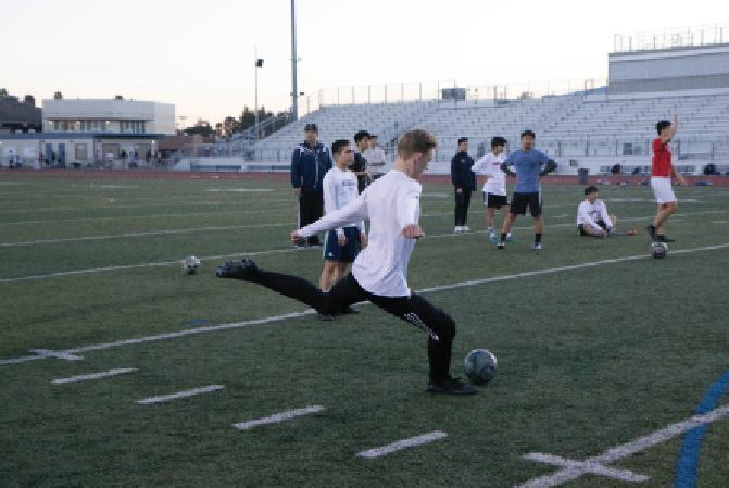 Junior Ryan Markert practices shooting goals. As of Jan. 29, the team has scored 43 total.