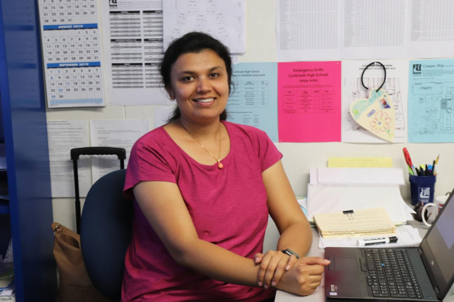 Math teacher Anshul Agrawal sits in her classroom after school.