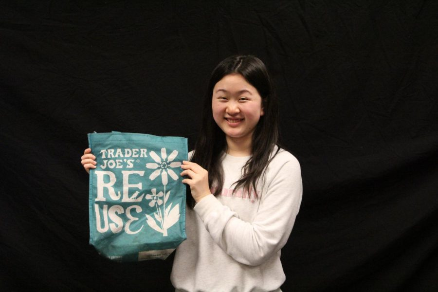 Writer Aileen Xue holds up a bag from Trader Joes.