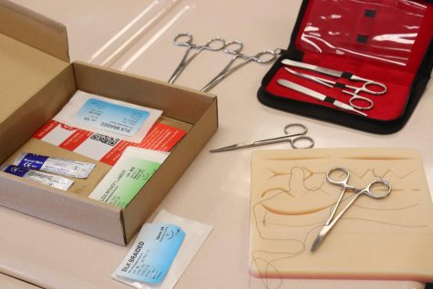 This box contains all the materials needed to practice suturing, in which surgeons carefully sew up a wound.