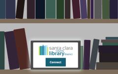 An illuminated tablet on a dark library shelf.