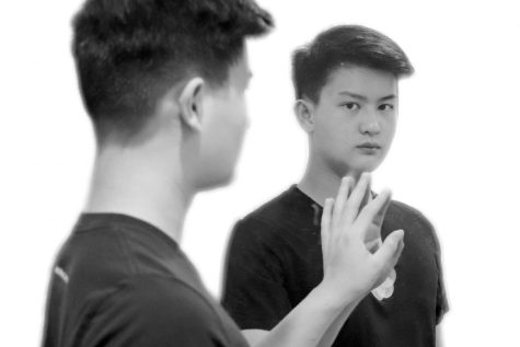 The writer, Bennie Chang, staring into the mirror and pondering over the truth about racism.