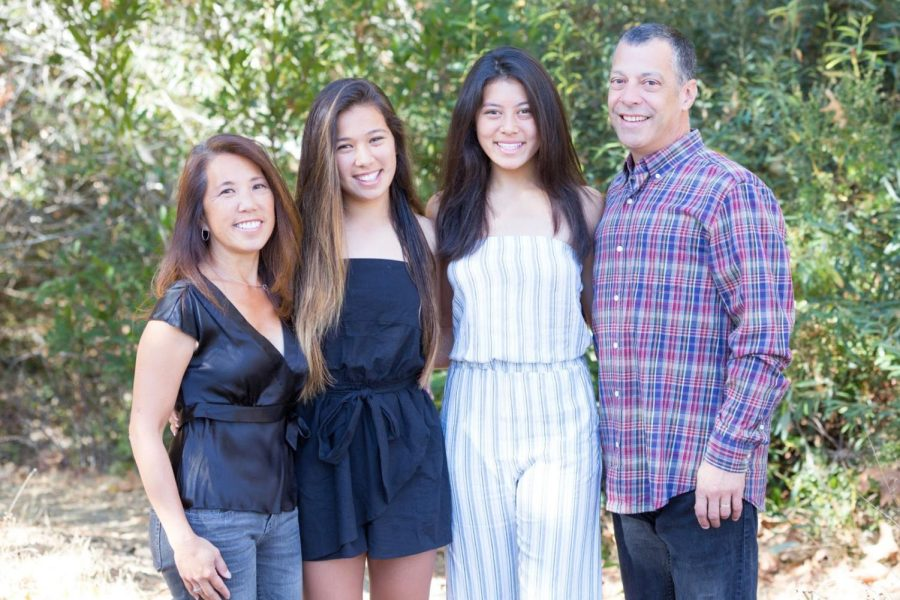 Rei Trujillo, second from right, poses for a photo with her family. (Photo used with permission of Jamie Chan.)