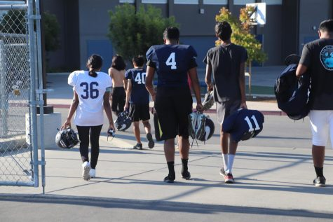 Kasturi Kirubaharan walking away from the field after practice with the rest of the team.